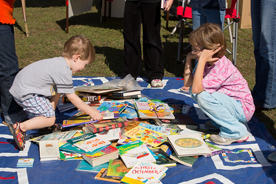 Philip and Mackenzie each select their prize from many books at the East Parker County Library booth.