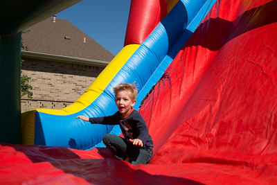 Austin Williams of Willow Park enjoys the inflatable slide at First Baptist Church of Willow Park during Park Fest.