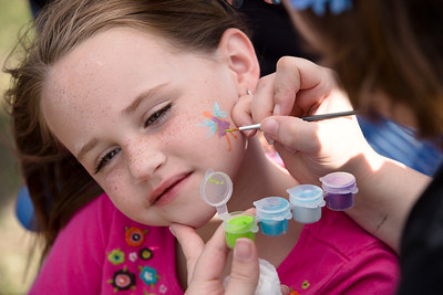 Brooklyn Carruth, 6, has her face painted with a fairy.