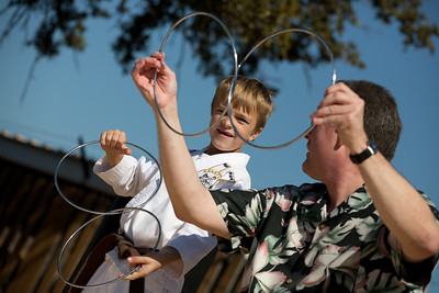 Randy Keck performs a ring trick with the help of 8 year old Mikey.