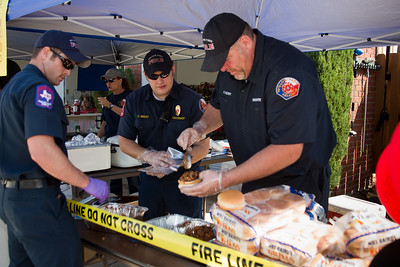 Firefighters Mike Kelly, Chris Seeley and Kyle Victry prepare chopped beef sandwiches.