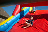 Cayden Ellis and his sister Kyla slide down the inflatable slide at First Baptist Church of Willow Park during Park Fest.