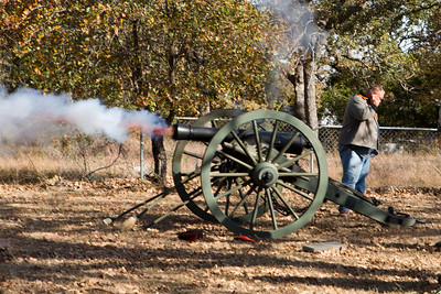Flames shoot out of a  12 pound Howitzer cannon during the artillery fire salute to Robertson.  Commander Walden estimates the cannon's value at $60,000.