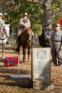 Civil War Veteran Albert M. Robertson's tombstone was restored  by the Sons of Confederate Veterans.  From left: Color Guard members Tom Tierce and David Wilson (mounted) and Dan Dvizi with the riderless horse.