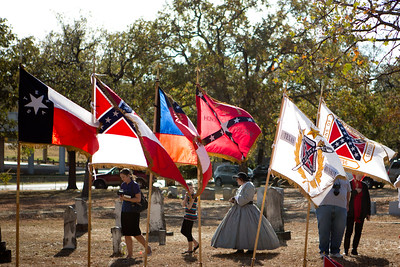 Flags unfurled in the breeze at the memorial service.