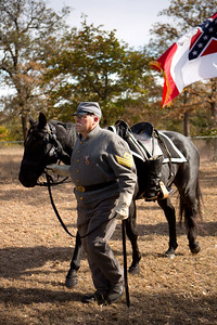 Dan Dvizi leads the caparisoned or riderless horse in a procession during the memorial honoring Albert Robertson.