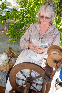 Brenda Dearman demonstrates spinning alpaca into yarn.