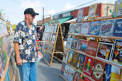 Al Babina of Grand Prairie, browses old signs on York Avenue.