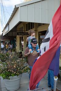 Chris Columbus gives his grandson Clark a ride near antique alley.
