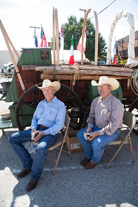 Russ Scott and Bobby Burleson greet visitors at the Parker County Cowboy Church chuck wagon.