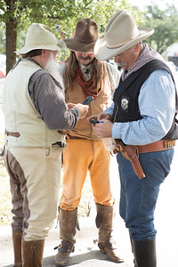Legends of Texas entertainers check their cell phones between performances. From left: J. L. Hamilton, Perry Sampley and Scott Kniffen.