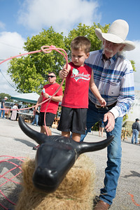 Lennon Anglin learns how to rope a steer with coaching from Johnny Davis.