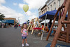 Kenna Dalrymple walks near swings for sale on the square.