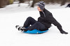 Grant Goldberg rides a saucer down an icy street in east Parker County Saturday.