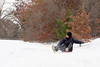 Daniel Chruscielski brakes with his foot after sledding down an icy hill.