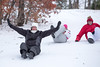 Claire Wittbold slides down a hill Friday with Hannah Wittbold and Madi Hartman.