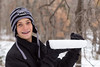 Grant Goldberg holds a thick slab of ice that formed on top of a trampoline Saturday.