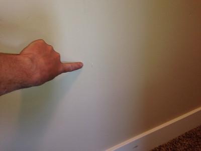damaged wall - upstairs landing