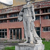 Statue of female textile worker at abandoned factory near Berat, Albania