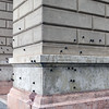 Memorial to the Oct. 1956 uprising : bullet impacts at the entrance to the Ministry of Agriculture in Budapest, Hungary