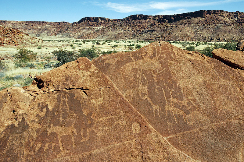 Ancient petroglyphs on red sandstone rocks at Twyfelfontein, Namibia