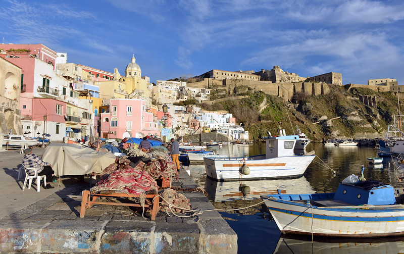 Corricella harbour and Castello d'Avalos on Procida island, Italy