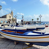 Fishing boats in the old harbour of Lipari, Italy