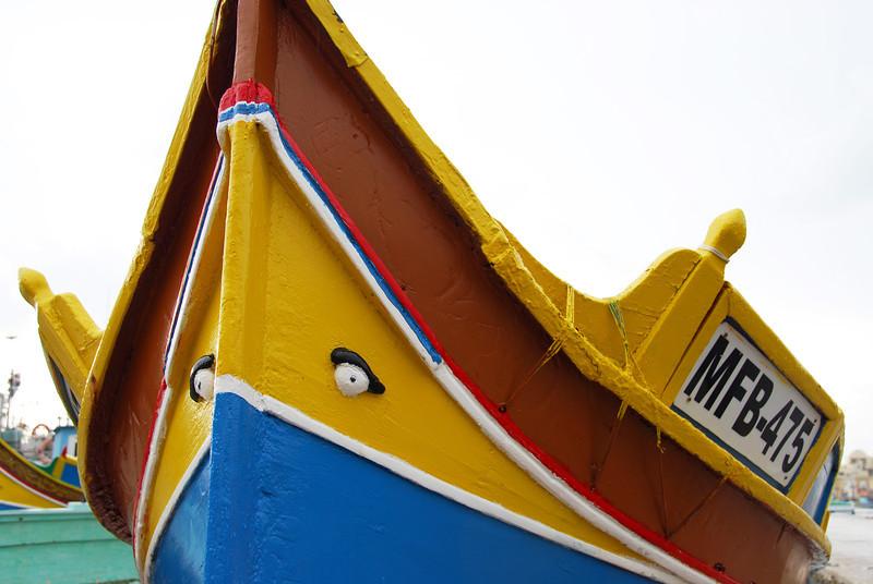 Brightly painted fishing boat in Marsaxlokk, Malta