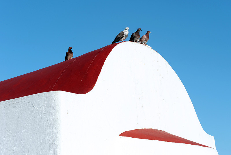 Doves on chapel in Mykonos, Greece