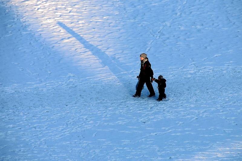Afternoon stroll across frozen lake, Norway