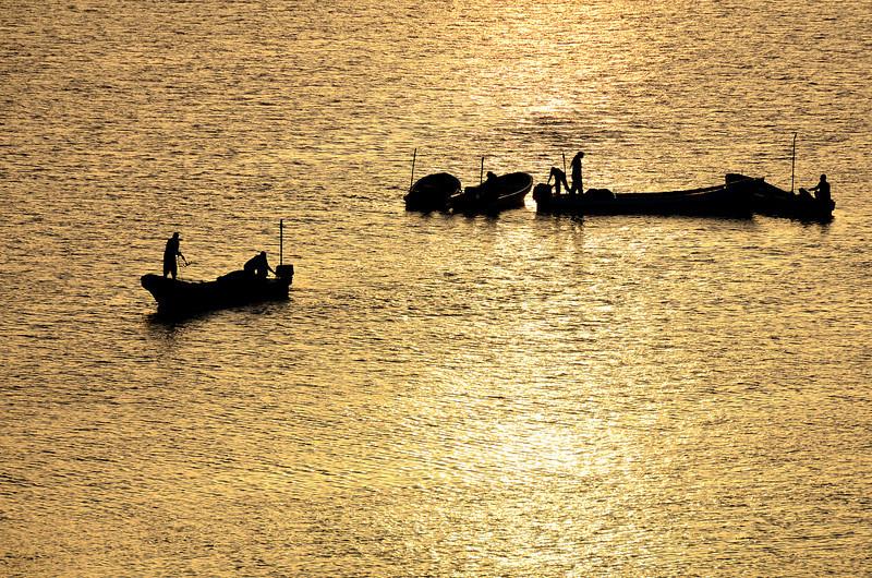 Fishermen readying for night fishing trip on the Batinah coast, Oman