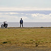 Pensive biker overlooking the sea, western Canada