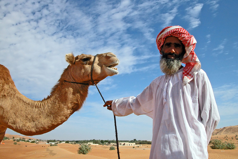 Proud camel owner in the northern Wahiba sands, Oman