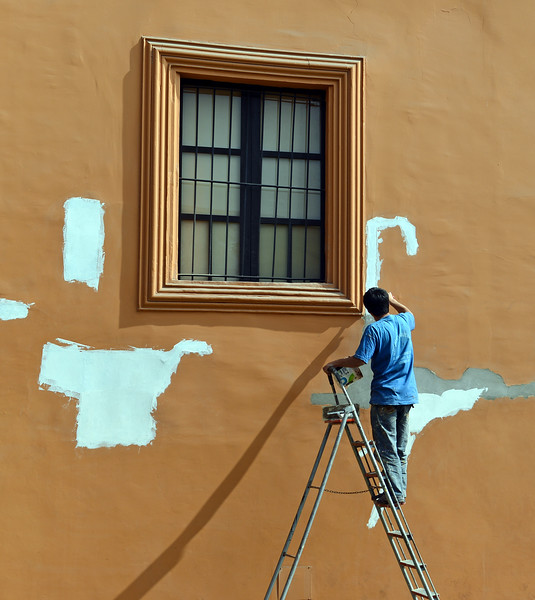 'Long-armed' painter at the convent of Santo Domingo in Lima, Peru