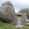 Granite boulder and farm hut in precarious balance on Tinos island, Greece