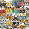 Collection of car license plates on wall in Bonaire