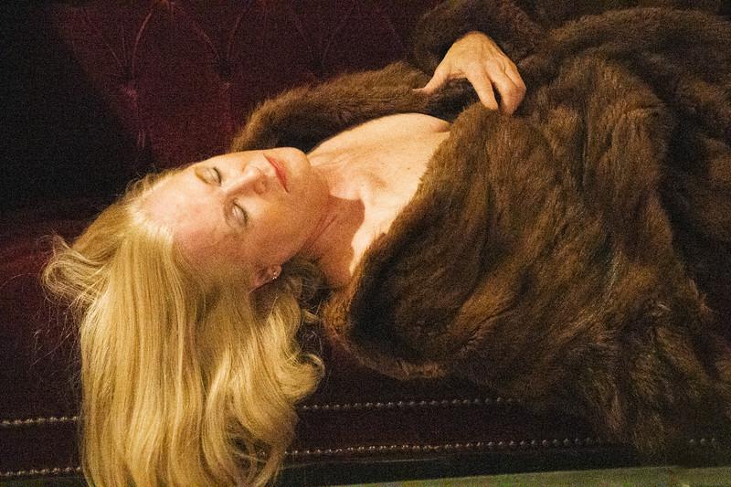 DeeDee laying down in fur coat