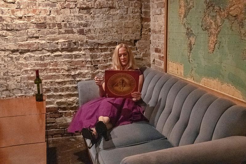 DeeDee in purple dress in the Speakeasy