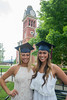 Two woman graduates smiling at camera
