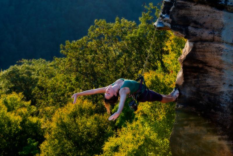 Rock climber feeling alive