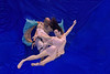 Nina and General dancing underwater in front of blue background