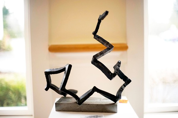 """BEN GARVER – THE BERKSHIRE EAGLE<br /> """"Angle Iron Play"""" is a sculpture in steel by Peter S. Barrettn At Kimbal Farms Life Care in Lenox, part of an exhibition with photographers Dan Mead and Sally Eagle."""