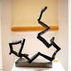 "BEN GARVER – THE BERKSHIRE EAGLE<br /> ""Angle Iron Play"" is a sculpture in steel by Peter S. Barrettn At Kimbal Farms Life Care in Lenox, part of an exhibition with photographers Dan Mead and Sally Eagle."
