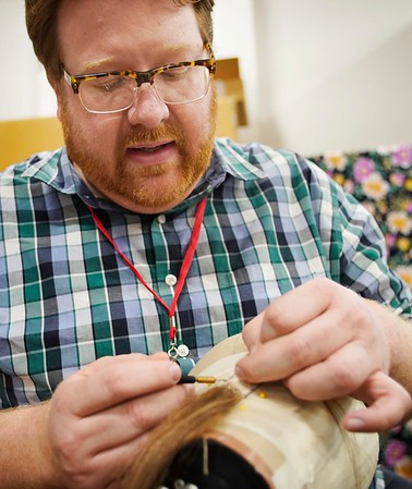 BEN GARVER — THE BERKSHIRE EAGLE<br /> Costume shop manager Trent Pcenicni demonstrates making a wig in the costume shop at Barrington Stage Company.