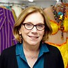"""BEN GARVER — THE BERKSHIRE EAGLE<br /> Barrington Stage Company (BSC) Artistic Director Julianne Boyd Poses among costumes from the Broadway production of """"On the Town."""""""