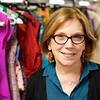 "BEN GARVER — THE BERKSHIRE EAGLE<br /> Barrington Stage Company (BSC) Artistic Director Julianne Boyd Poses among costumes from the Broadway production of ""On the Town."""