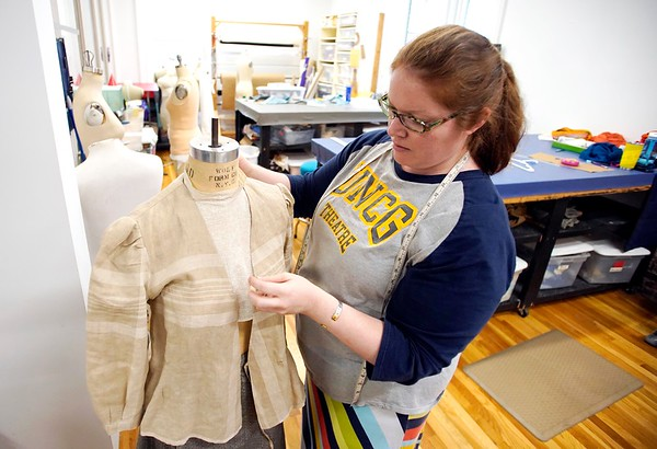 BEN GARVER — THE BERKSHIRE EAGLE<br /> Christina Massey, a draper at Barrington Stage Company, prepares a costume for Typhoid Mary in the costume shop.
