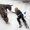 BEN GARVER — THE BERKSHIRE EAGLE<br /> Hayley Sumner cares for her horses at Berkshire horseworks in Richmond. Sumner is recovering from an ankle injury but is able to get out and check on her horses and donkeys. Sumner usees the animals for therapy. The donkeys are named Rodeo and Bolt.