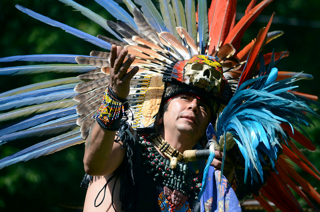. Gustavo Arias, a dancer from Kalpulli Atl-Tlachinolli from New York, dances in an Aztec tradition at the Rock, Rattle and Drum Pow Wow in Adams, Mass., Sunday Aug. 10. 2014.  The event attracts native American traditions from around the Northeast. (AP Photo / The Berkshire Eagle, Ben Garver)