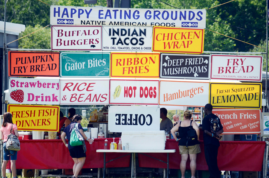 . A mix of tradition and contemporary foods feed visitors to the Rock, Rattle and Drum Pow Wow in Adams, Mass., Sunday Aug. 10, 2014.  THe event draws celebrants of Native American traditions form around the Northeast.  (AP Photo / The Berkshire Eagle, Ben Garver)